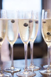 Champagne white wine glasses in wedding party Stock Image