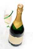 Champagne with wine glass. And green ribbon on white Stock Images