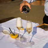 Champagne and wine glasses, alcohol, pouring champagne Stock Images