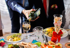 Champagne and wine glasses, alcohol, pouring champagne Royalty Free Stock Photos