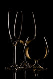 Champagne wine and whiskey glasses on dark background.  royalty free stock photo