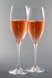 champagneexponeringsglas ros två Arkivbild