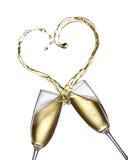 Champagnefärgstänk i form av hjärta arkivfoton