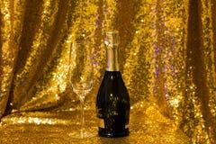 Champagneflasche und -glas Lizenzfreie Stockfotos