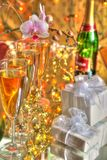 Champagnein glasses,gifts and flowers. Royalty Free Stock Image