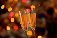 Champagner on Glass Table with Bokeh background Royalty Free Stock Photos