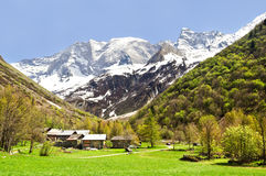 Champagny en Vanoise. A small village in a green valley with a snowy mountain behind Royalty Free Stock Image