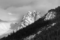 Champagny le haut winter landscape black and white. Champagny le haut France winter landscape mountains snow and clouds in black and white royalty free stock images