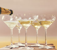 Champaign being pored into glasses Royalty Free Stock Images