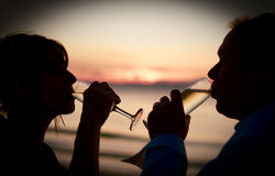 Champaign Celebration. Husband And Wife Drink To Success While Toasting To The Dawn Of A New Day In A Champaign Celebration Royalty Free Stock Photos