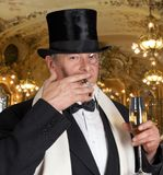 Champaign dandy. Dandy figure with bow-tie, top hat and a monocle Royalty Free Stock Images