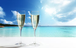 Champaign Glasses. On beach and blue sky royalty free stock image
