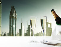 Champaign Glasses and  skyscrapers of Dubai Stock Photography