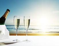 Champaign Glasses and sunset on Seychelles beach. Africa Stock Photo