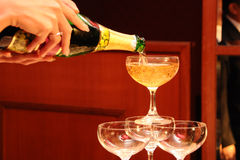 Champaign pour. Pouring a glass of Champaign into fluted glass Stock Photography