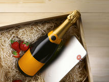 Champaign. Strawberry and chocolate in the wood box stock photography