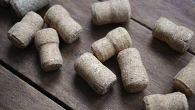 Champaigne corks on wood. Row of champaigne corks on wooden background, diagonal camera movement stock footage