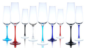 Champaigne glasses. Nine isolated colourful champaigne glasses on white background with reflection Stock Photo