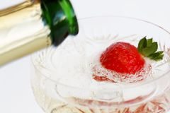 Champaigne pouring on strawberry. Sparkling wine Royalty Free Stock Photography