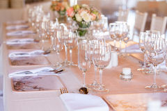 Champaigne and wine glasses on table at wedding reception. Champaigne and wine glasses on a decorated table at wedding reception Royalty Free Stock Image