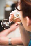 Champanhe bebendo da mulher nova fotografia de stock royalty free