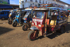 Champasak Laos - Nov23- group of three wheel vehicle queue  in D Royalty Free Stock Images