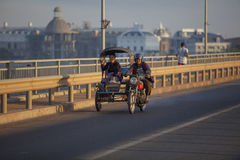 CHAMPASAK LAOS - NOV 23 : laos people traveling by motorcycle wi Stock Images