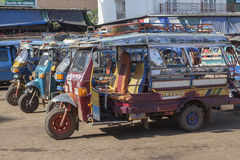 CHAMPASAK LAOS - NOV 23 : three wheel vehicle in pakse market im Royalty Free Stock Image