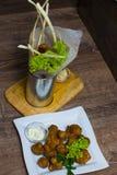 Champiñones fritos con la salsa Foto de archivo