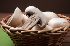 Champignon mushroom. In little basket, vegetables for appetizer and side dish Stock Photos