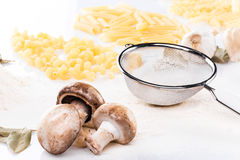 Champignon mushrooms with pasta and garlic stock photography