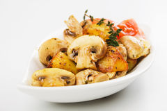 Champignon mushrooms with roasted potato Royalty Free Stock Photos