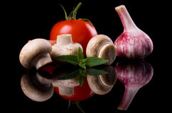 Champignon mushrooms with tomato and garlic Royalty Free Stock Images