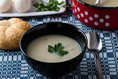 Champignon soup in black bowl Royalty Free Stock Photography