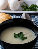 Champignon soup in black bowl Royalty Free Stock Photos