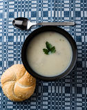 Champignon soup in black bowl Royalty Free Stock Image