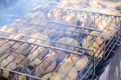 Champignon white mushrooms grilled on grill or barbecue in smoke coals Royalty Free Stock Photo