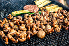 Champignon white mushrooms grilled on grill or BBQ steam and small drops of water. Cooking mushrooms on the grill. Stock Photo