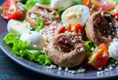 Champignon white mushrooms grilled. Grilled vegetables on a grill close up. Royalty Free Stock Photo