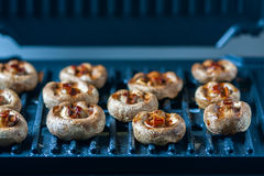 Champignon white mushrooms grilled. Grilled vegetables on a grill close up. Stock Image