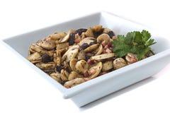 Champignons avec du jambon et des raisins secs Images stock