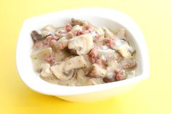 Champignons with bacon Stock Photos