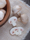 Champignons in a ceramic plate on old wood Royalty Free Stock Photo
