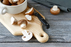 Champignons on a cutting board Stock Photography