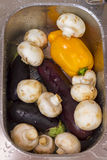 Champignons, eggplant, peppers bolgalsky washed vegetables in bo Royalty Free Stock Photos