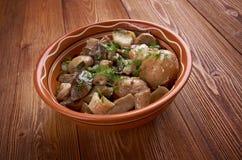Champignons frits avec le lard et les pommes de terre Photographie stock libre de droits