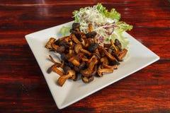 Champignons frits délicieux images stock