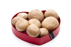 Champignons in the heart Stock Photos