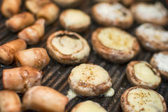 Champignons mushrooms on grill. Champignons mushrooms on the grill Stock Photo