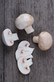 Champignons on old wood table Stock Images